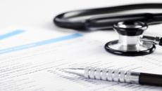 Paperwork and stethoscope