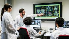 Group of doctors looking at a monitor