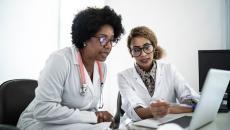 Doctors looking at a computer