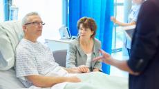 Senior patient speaking to doctor.