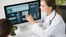 Doctor looking at medical image.