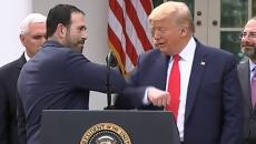 Bruce Greenstein of LHC Group gives President Trump an elbow bump.
