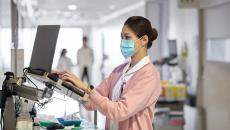 A medical professional using a computer at a hospital.