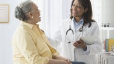 Senior patient talking to woman doctor.