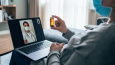 Patient consults via telehealth with doctor at home