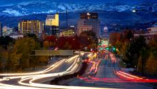 Idaho scene, city buildings below mountain range