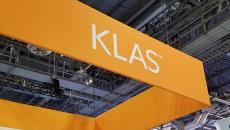 KLAS banner at an event booth