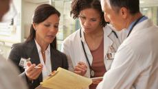 Hospital exec talking to doctors