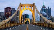 Photo of Pittsburgh through a bridge arch
