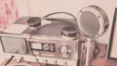 An old-timey microphone and radio setup represent our weekly digital health podcast.
