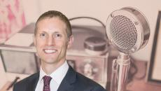 Guest Matt Fisher in front of an old-timey microphone and radio setup represents our weekly digital health podcast.