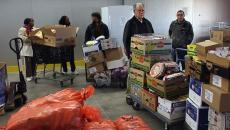 Food pantry workers unloading boxes