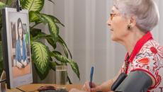 Senior woman attending a telehealth appointment.