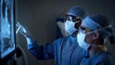 Surgeons looking at display