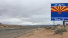 "A highway sign with the words ""Welcome to Arizona"""