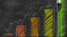 Growth chart on chalkboard