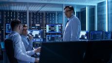 Workers meet in a computer room