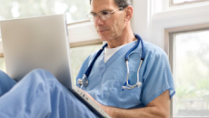 Doctor using laptop