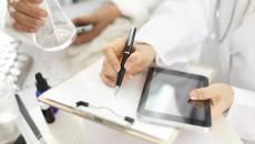 Lab workers using tablet