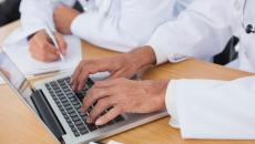 close up on doctor using laptop