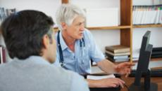 Doctor and patient looking at medical record