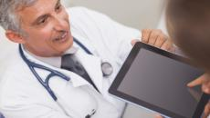 doctor with patient using tablet