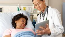 Doctor and patient with tablet