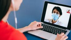 Patient speaking with doctor on laptop via telemedicine