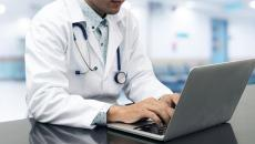 A doctor on a laptop