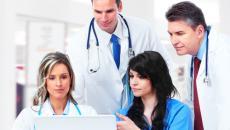 doctors looking at computer