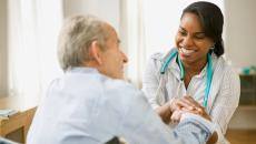 Doctor talking to elderly patient.