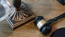 A gavel sitting on a desk