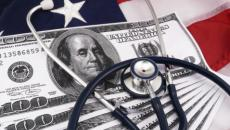 stethoscope on money and American flag