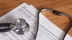health insurance papers with stethoscope