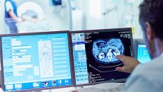 Doctor looking at imaging screen.