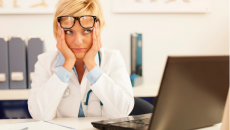 Frustrated doctor at laptop