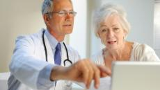 Doctor and patient with EHR