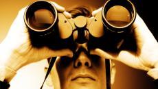 man using binoculars