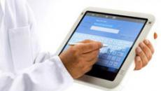 close up on doctor using an EHR