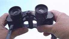hands holding binoculars