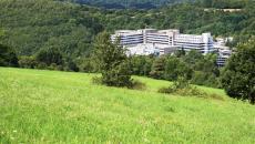 Hospital viewed from a hillside.