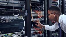 IT worker looking at servers.