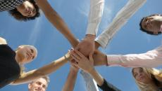 hands in a circle indicating teamwork