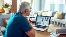 A patient speaks with a doctor via telehealth