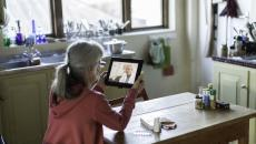 Patient attending telehalth appointment on tablet