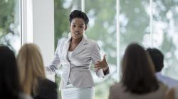 business woman talking to group of people