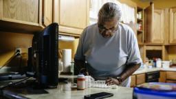 Senior woman sorting medication