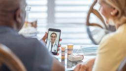 People attending telehealth appointment on smartphone