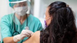 Nurse administers COVID-19 vaccine
