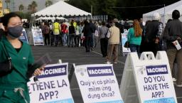 People lining up for vaccines
